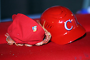 MEXICO CITY - MARCH 10: A cap bearing the tournament logo sits next to a Cuba batting helmet during the Pool B, game four against Australia in the first round of the 2009 World Baseball Classic at Foro Sol Stadium in Mexico City, Mexico, Tuesday March 10, 2009. Cuba defeated Australia 5-4. (Photo by Paul Spinelli/WBCI/MLB Photos)