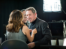Oracle CEO Larry Ellison talks with CNBC host Maria Bartiromo following a live television interview onsite at the Oracle OpenWorld conference in San Francisco, Calif.   Ellison said they plan to grow their business through their cloud computing products and services.