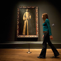 LONDON, ENGLAND - OCTOBER 16:  A National Gallery employee walks in front of  Saint Francis by  Francisco de Zurbaran at 'The Sacred Made Real Exhibition' at the National Gallery on October 16, 2009 in London, England. The Exhibition running from October 21 to January 24, 2010 includes masterpieces by Velasquez and Francisco de Zurbaran which are displayed for the very first time alongside Spain's polyccrome painted sculptures  ...***Agreed Fee's Apply To All Image Use***.Marco Secchi /Xianpix. tel +44 (0) 771 7298571. e-mail ms@msecchi.com .www.marcosecchi.com