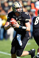 WEST LAFAYETTE, IN - SEPTEMBER 29: Caleb TerBush #19 of the Purdue Boilermakers rolls out of the pocket to pass against the Marshall Thundering Herd at Ross-Ade Stadium on September 29, 2012 in West Lafayette, Indiana. (Photo by Michael Hickey/Getty Images) *** Local Caption *** Caleb TerBush