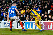 Andy Barcham (17) of AFC Wimbledon battles for possession with Jack Whatmough (16) of Portsmouth during the EFL Sky Bet League 1 match between Portsmouth and AFC Wimbledon at Fratton Park, Portsmouth, England on 1 January 2019.