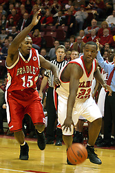31 January 2004  Najeeb Echols bites his tongue and heads for the hoop. Bradley University visit Redbird Arena in Normal Illinois, home of the Illinois State University Redbirds.