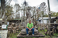 Adam Morales in his yard that is part of Adam's Cypress Swamp Driftwood Family Museum in Pierre Part, Louisiana, which he created.