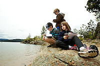 Emma McLaughlin-Orton, 9, right, Justin Jaworski, 8, center, and Jameson Joiner, 8, sketch the scenic view from the south side of Tubbs Hill during an field trip Thursday with their class from Sorensen Magnet Elementary. The students toured the area while learning about native plants, wildlife and conservation.