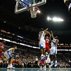 January 3, 2011; New Orleans, LA, USA; Philadelphia 76ers shooting guard Evan Turner (12) shoots over New Orleans Hornets center Emeka Okafor (50) and small forward Quincy Pondexter (20) during the second quarter at the New Orleans Arena.   Mandatory Credit: Derick E. Hingle