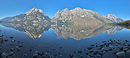 """Jenny Lake Panorama, Grand Teton Mountain Reflections in the calm water of Jenny Lake in Grand Teton National Park.<br /> <br /> For production prints or stock photos click the Purchase Print/License Photo Button in upper Right; for Fine Art """"Custom Prints"""" contact Daryl - 208-709-3250 or dh@greater-yellowstone.com"""