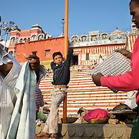 Hindu pilgrims gather at the banks of the Ganges river at the holy city of Varanasi, also known as Benares...Photo: Tom Pietrasik.Varanasi, Uttar Pradesh, India.February 3rd 2010
