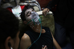 Tear gas was inescapable in Sanabis, and people were brought to a makeshift clinic to receive treatment.