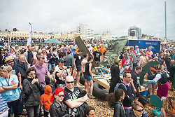 © Licensed to London News Pictures. 25/06/2016. Brighton, UK. Thousands of people spend the day at the biggest free charity beach event in the world, Paddle round the Pier 2016 and take part in varied water sports and games. Photo credit: Hugo Michiels/LNP