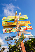 Humorous directional sign in New Plymouth on Green Turtle Cay, Bahamas.