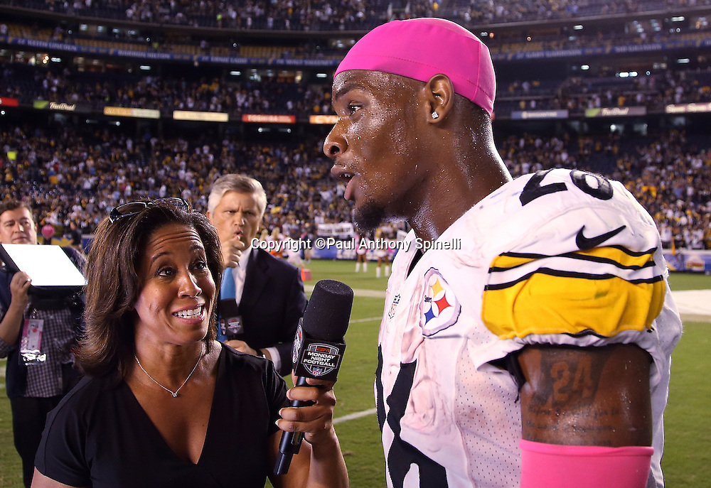 Pittsburgh Steelers running back Le'Veon Bell (26) does a postgame television interview after the 2015 NFL week 5 regular season football game against the San Diego Chargers on Monday, Oct. 12, 2015 in San Diego. The Steelers won the game 24-20. (©Paul Anthony Spinelli)