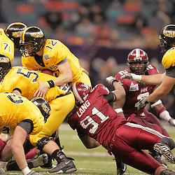 21 December 2008:  Southern Miss quarterback Austin Davis (12) is sacked by Troy defensive end Brandon Lang (91) during a 30-27 overtime victory by the Southern Mississippi Golden Eagles over the Troy Trojans in the  R+L Carriers New Orleans Bowl at the New Orleans Superdome in New Orleans, LA.