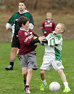Monroe, New York - Two players push each other as the official gets ready to blow his whistle during a 12-and-under game between St. Brendan's Gaelic Football Club and the Rockland Gaelic Athletic Association on March 31, 2012. ©Tom Bushey / The Image Works