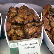 Smoked mussels for sale at The Coromandel Smoking Company, Coromandel Town. New Zealand. 28th November 2010. Photo Tim Clayton.