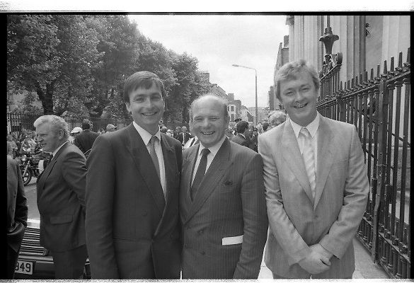 Mass For The 26th Dail.     (T3)..1989..29.06.1989..06.29.1989..29th June 1989..After the General Election  a mass took place today at the Pro-Cathedral in Dublin. The mass was to bless   the incoming TD's who were successful in their election to the Dáil...Members of the 26th Dáil are pictured making their way back to Leinster House after the mass in the Pro-Cathedral.