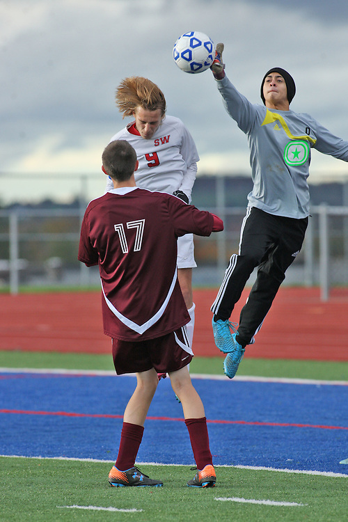 Dunkirk goalie Felix Garcia bats away a header attemp at goal by Southwestern's Jackson Rybicki during first period action 10-14-15 photo by Mark L. Anderson