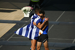 November 13, 2016 - Athens, Greece - Kostas Gelaouzos and Christoforos Merousis congratulate each other..50.000 long range runners take part in the 42 killometers long Athens Marathon the Authentic in Greece starting from the City of Marathona and ending at Kalimarmaro Stadium in Athens. (Credit Image: © George Panagakis/Pacific Press via ZUMA Wire)