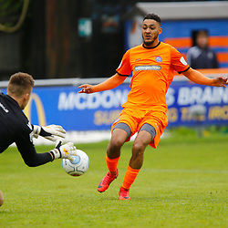 Braintrees Reece Grant tries to beat Gloucesters Andy Hannah during the Vanorama National League South match between Braintree Town FC and Gloucester City FC at the IronmongeryDirect Stadium, Essex on 28 April 2018. Photo by Matt Bristow.
