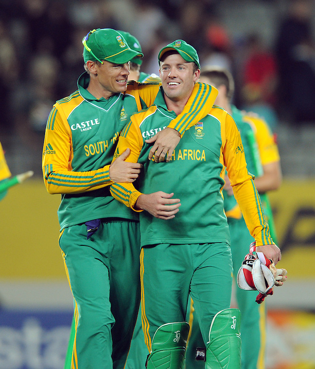 Man of the match, South Africa's Johan Botha, left, walks off with his captain AB de Villiers after their win over New Zealand in the third twenty/20 International Cricket match, Eden Park, Auckland, New Zealand, Wednesday, February 22, 2012. Credit:SNPA / Ross Setford