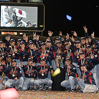 23 March 2009: Team Japan pose with the trophy as they won its second consecutive World Baseball Classic Championship at the end of  the 2009 World Baseball Classic final game at Dodger Stadium in Los Angeles, California, USA. Japan defeated Korea 5-3