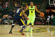 WACO, TX - MARCH 5: Lester Medford #11 of the Baylor Bears brings the ball up court against the West Virginia Mountaineers on March 5, 2016 at the Ferrell Center in Waco, Texas.  (Photo by Cooper Neill/Getty Images) *** Local Caption *** Lester Medford