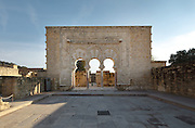 Facade of the House of Yafar, or portico of the prime minister, at the Palace of Madinat az-Zahra, a royal palace built 936-945 by Abd-ar-Rahman III al-Nasir, 912ñ961, Umayyad Caliph of Cordoba, outside Cordoba, Andalusia, Southern Spain. The portico consists of 3 horseshoe arches supported by 4 columns, surrounded by a rectangular frame with carved decoration. The complex was extended under Al-Hakam II, 961-976, and sacked and abandoned in 1010. Picture by Manuel Cohen
