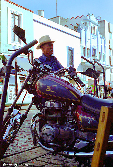 Motorcyclist of Mexico street scene photographed by Star Nigro.