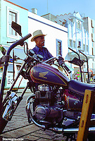 Motorcyclist of Mexico street scene photographed by Star Nigro.<br /> <br /> <br /> © 2019 All artwork is the property of STAR NIGRO.  Reproduction is strictly prohibited.