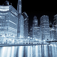 Chicago downtown city skyline at night along the Chicago River with Wabash Avenue Bridge (Irv Kupcinet Bridge), Crain Communications Building (London Guarantee Building 360 North Michigan Avenue), Mather Tower (75 East Wacker Drive), Hotel 71, (71 E Wacker Drive), Jewelers Building (35 East Wacker Drive), Unitrin Building (Kemper Building 1 East Wacker Drive), Renaissance Hotel (1 West Wacker Drive), and Leo Burnett Building (35 West Wacker Drive)