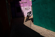 A downhill racer between the streets of Guanajuato City in Mexico.