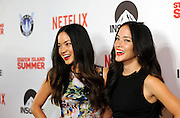 Katie Cockrell, left, and her twin sister Kellie Cockrell pose on the red carpet at the premiere of the movie Staten Island Summer at Sunshine Cinema, Tuesday, July 21, 2015, in New York.  The new comedy debuts on Netflix on July 30, 2015 and is available for Digital download. (Photo by Diane Bondareff/Invision for Paramount Pictures/AP Images)