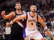 Oct. 12, 2012; Phoenix, AZ, USA; Phoenix Suns center Marcin Gortat (4) boxes out Portland Trail Blazers forward Victor Claver (18) in the first half at US Airways Center. Mandatory Credit: Jennifer Stewart-US PRESSWIRE