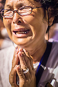"""04 FEBRUARY 2013 - PHNOM PENH, CAMBODIA:  A Cambodian woman cries out at the cremation of their former King Norodom Sihanouk during the King-Father's cremation service in Phnom Penh. Norodom Sihanouk (31 October 1922- 15 October 2012) was the King of Cambodia from 1941 to 1955 and again from 1993 to 2004. He was the effective ruler of Cambodia from 1953 to 1970. After his second abdication in 2004, he was given the honorific of """"The King-Father of Cambodia."""" Sihanouk died in Beijing, China, where he was receiving medical care, on Oct. 15, 2012.   PHOTO BY JACK KURTZ"""