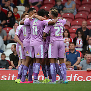 (Carlos) Orlando Sa (Reading striker) celebrating with Reading players after scoring the first goal during the Sky Bet Championship match between Brentford and Reading at Griffin Park, London, England on 29 August 2015. Photo by Matthew Redman.