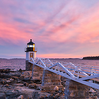 Maine photography of Marshall Point Lighthouse with its iconic wooden walkway. This beautiful New England lighthouse is located in Port Clyde, ME and marks the entrance to Port Clyde harbor.<br />