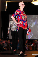 Wearing fashions from The Secret Ingredient, models .Lisa Hayes (left) and Emily Fleming on the runway during A'Wear Affair, the Noble Circle fundraising fashion show, at Sinclair College's David H. Ponitz Center, Saturday, February 23, 2013.  Hayes has been thriving beyond ductal infiltrating breast cancer for three years and two months.  Fleming has been thriving beyond breast cancer while pregnant in 2009 and stage 4 liver and bone cancer in 2012.