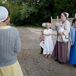 Mennonite women stand outside prior to a evening church service and meeting at the Mennonites Cuba Christian Brotherhood Church, a small build adjacent to the 5-Star Building in Cuba, Missouri on Wednesday, Sept. 28, 2016. (Photo by Keith Birmingham Photography)