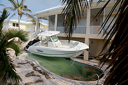 September 13, 2017 - Duck Key, Florida, U.S. - A boat sits over a swimming pool at a home in Duck Key that sustained significant damage from Hurricane Irma. The death toll from Hurricane Irma continued to climb Wednesday with at least 30 people dead across three states. (Credit Image: © Sun-Sentinel via ZUMA Wire)