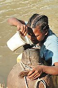 Africa, Ethiopia, Blue Nile, Young local girl taken water from the river