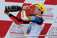 MARQUEZ Alex (SPA) of HONDA, championship winner,  celebrates his 3rd place on the podium during the Moto 3 Valencia Grand Prix at Ricardo Tormo circuit, Cheste in Spain on november 09, 2014 - Photo Milagro / DPPI