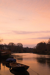 Richmond, London, February 17th 2016. The delicate hues of the sky are reflected in the water as dawn breaks over the River Thames. <br /> ///FOR LICENCING CONTACT: paul@pauldaveycreative.co.uk TEL:+44 (0) 7966 016 296 or +44 (0) 20 8969 6875. &copy;2015 Paul R Davey. All rights reserved.