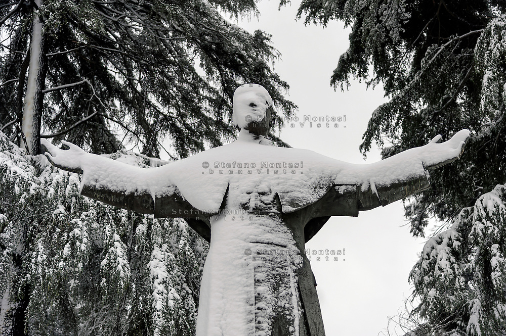 ROME, ITALY - FEBRUARY 26: The statue of Pope Pius XII is covered by snow in the San Lorenzo district, after the snowfall in the night connected to the arrival of Burian that have whitewashed the capital on February 26, 2018 in Rome, Italy.