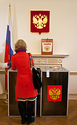 © licensed to London News Pictures. London, UK 04/03/2012. A Russian citizen placing her vote in to a ballot box at The Embassy of the Russian Federation in London as the election for the President of the Russian Federation takes place today (04/03/12). Photo credit: Tolga Akmen/LNP