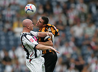 Photo: Lee Earle.<br /> West Bromwich Albion v Hull City. Coca Cola Championship. 05/08/2006. Albion's John Hartson (L) battles in the air with Damien Delaney.