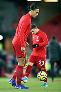 Liverpool defender Virgil van Dijk (4) warming up during the Premier League match between Liverpool and Everton at Anfield, Liverpool, England on 4 December 2019.