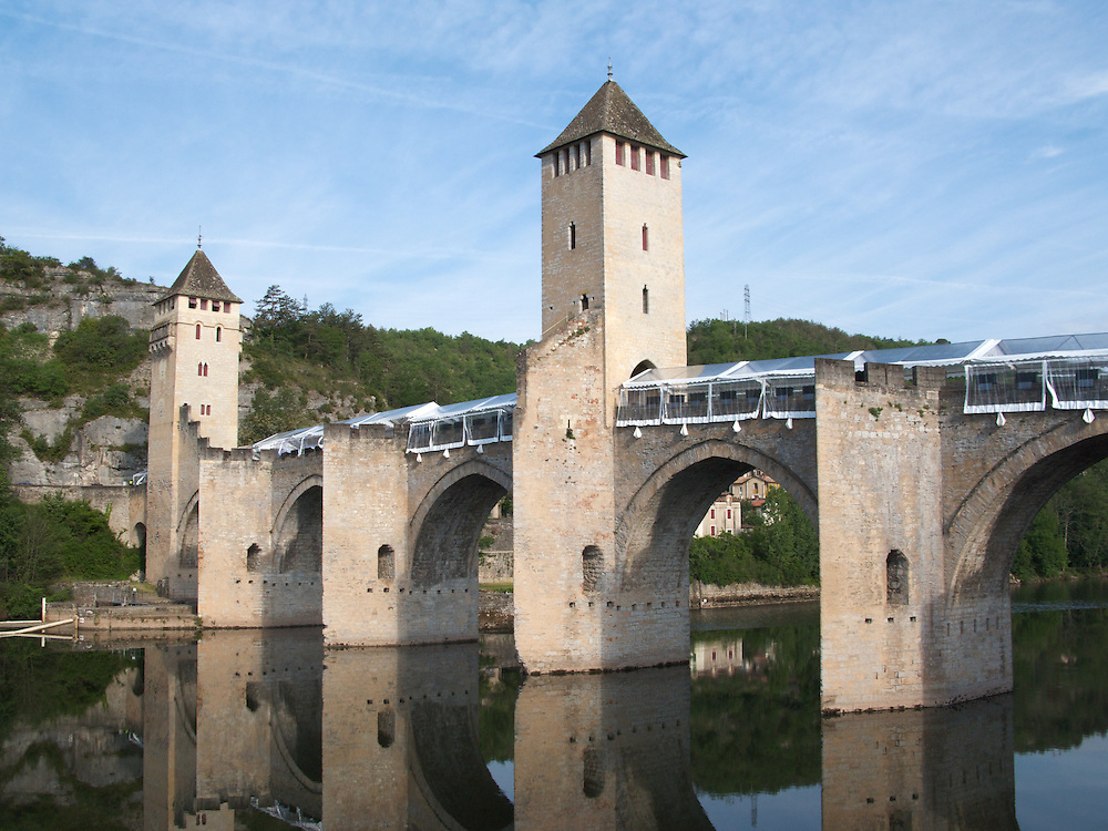 The 14th Century Valentre Bridge in Cahors is a symbol of the town. It was started in 1308 and completed in 1378. Cahors has had a rich history since Celtic times and attracts many visitors each year to this part of Lot in the Midi-Pyrennes of South-West France.