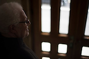 New York, NY, April 2, 2016. Franciscan Brother Paschal DeMattea, O.F.M. opens the door to St. Anthony of Padua Friary in New York City. 04/02/2016. Photo by George Goss/NYCity News Service.