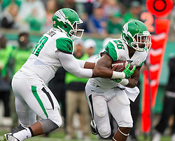 Oct 24, 2015; Huntington, WV, USA; North Texas Mean Green quarterback DaMarcus Smith hands the ball off to running back Jeffrey Wilson during the first quarter at Joan C. Edwards Stadium. Mandatory Credit: Ben Queen-USA TODAY Sports