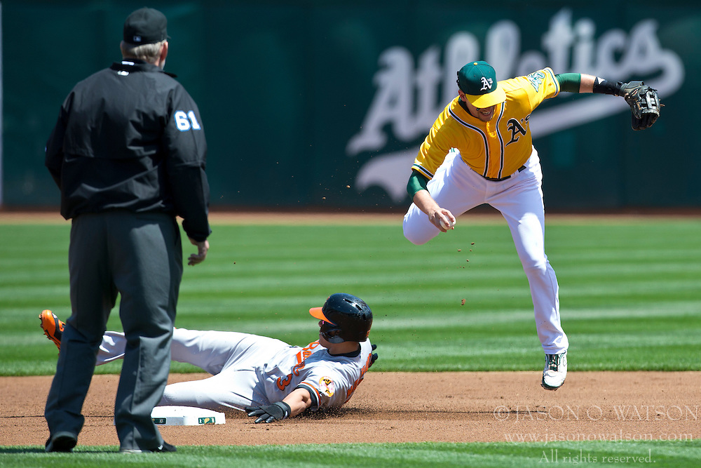 OAKLAND, CA - APRIL 27: Manny Machado #13 of the Baltimore Orioles breaks up a double play attempt by Jed Lowrie #8 of the Oakland Athletics during the first inning at O.co Coliseum on April 27, 2013 in Oakland, California. The Baltimore Orioles defeated the Oakland Athletics 7-3. (Photo by Jason O. Watson/Getty Images) *** Local Caption *** Manny Machado; Jed Lowrie