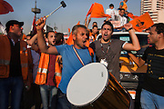 Supporters of Egyptian Islamist presidential candidate Abdul Moneim Aboul Fotouh beat a drum and cheer for their candidate during a May 18, 2012 campaign march on the Nile River Bridge in downtown Cairo, Egypt. The candidate will find out just how much support he has during the May 23-24th voting, Egypt's first truly democratic presidential vote in its history. (Photo by Scott Nelson)